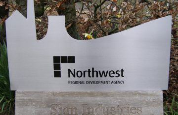 Shaped stainless steel sign