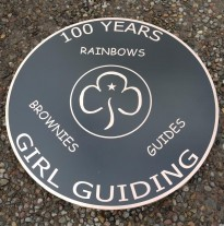Bronze reverse engraved, and backfilled black. 3 mm thick x 75 cm in diamater with studs and template on the rear