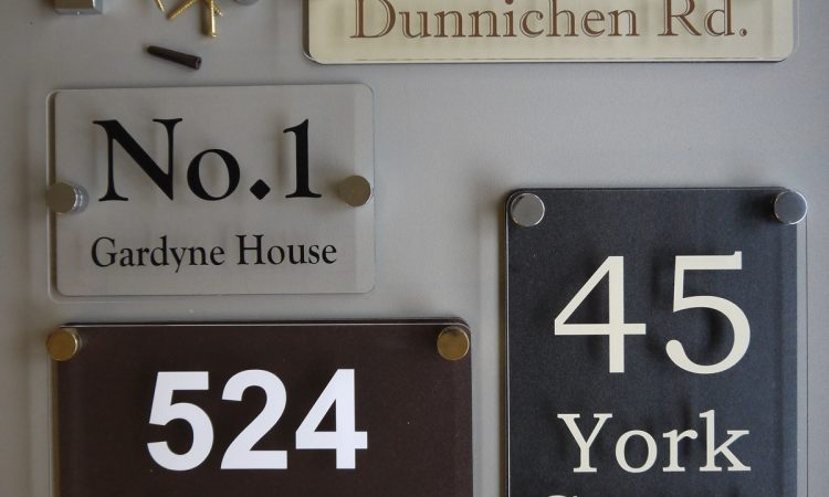 Various sized Perspex House Signs