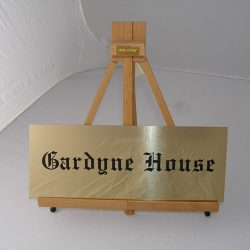 brass house sign