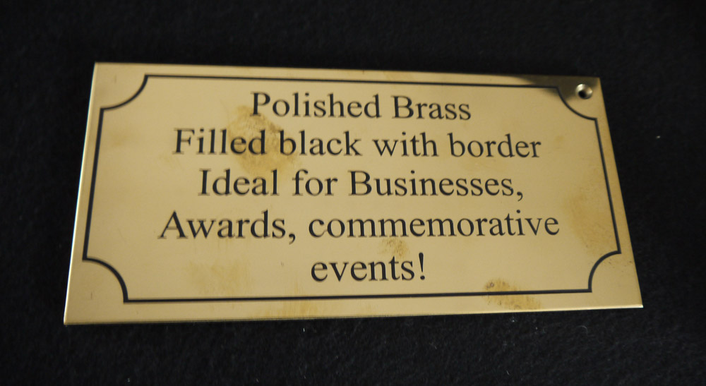 Polishing brass plaques